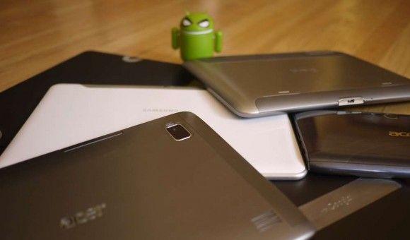 Фигурка Android за кучей планшетов